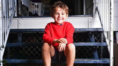 A happy Nicholas Baxter 6 sits on the front steps of his family's home in Wulguru. PIC: Z