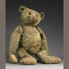 Large Steiff Teddy bear, German circa 1909  Brown mohair, straw filled bear with black boot button eyes, elongated muzzle, hump to back, stitched claws, swivel head and jointed at shoulders and hips, remains of felt paw pads, (general wear and bald patches to mohair, three holes and stitches missing to snout and mouth, pads recovered, stuffing loose), (28in) tall.