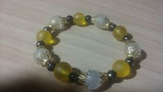 Pretty and sophisticated gold, yellow and black stretch bracelet. by tonispretties on Etsy