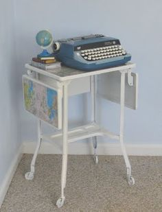 An old typewriter stand upcycled into a beautiful map covered laptop stand.