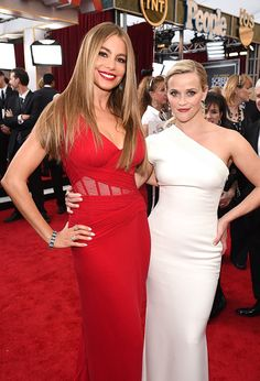 Sofia Vergara and Reese Witherspoon attend TNT's 21st Annual Screen Actors Guild Awards at The Shrine Auditorium on January 25, 2015 in Los Angeles, California.