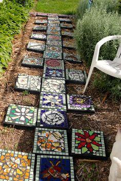 the garden junkie.  Mosaic stepping stone garden path.