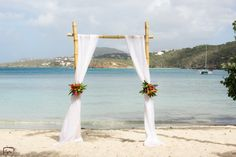 Beach wedding ceremony decor idea - wooden arch with white fabric + bright flowers {Crown Images photography by Sage}