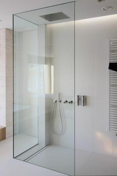 Clean and minimal bathroom designed by Katarzyna Kraszewska. Love the hardware free glass shower enclosure.