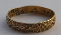 """Gold posy ring with inscription bearing traces of black enamel. The exterior decorated with strapwork and pellets. Very small.  """"A token of good will"""""""
