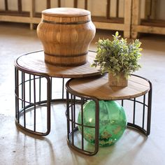 Taking their cue from rustic influences, the Farmer's Barrels Nesting Tables are timeless yet unique. Featuring natural wood tops and metal tube bases, the set of two tables are great for small spaces ...  Find the Farmer's Barrels Nesting Tables - Set of 2, as seen in the Rustic Meets Refined Collection at http://dotandbo.com/collections/rustic-meets-refined?utm_source=pinterest&utm_medium=organic&db_sku=101365
