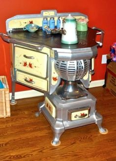 Antique Wood / Coal Stove - I've never seen one like this.  Would love it.