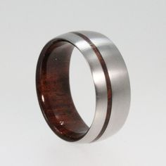 Mens Titanium Wedding band with a Wood sleeve and Wood Pinstripe. $195.00, via Etsy.