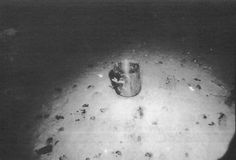 A copper kettle from Titanic's galley lies in the debris field, a third of a mile south of the bow of the great luxury liner at the bottom of the Atlantic Ocean. Strong bottom currents and particles in the water have polished the kettle so that it appears as clean as it was when the ship sank during its maiden voyage on April 15, 1912. (Denver Post Archives)