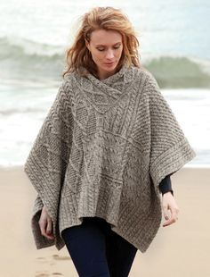 V Neck Aran Cable Poncho - Soft Merino Wool & Made in Ireland; order direct from the Aran Sweater Market, Aran Islands, Ireland.Authentic, quality Aran cable poncho with stylish v neck feature Poncho Shawl, Knitted Poncho, Poncho Knitting Patterns, Knitting Designs, Crochet Woman, Knit Crochet, Ruana Wrap, Wool Cape, Pulls