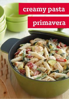 Creamy Pasta Primavera — Fresh zucchini and asparagus get together with penne pasta, chicken and two kinds of cheese for a delicious way to get some veggies on the table.