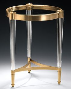 Round table with solid crystal legs and antiqued brass trim. Pinworthy Tables & Consoles We Love at Design Connection, Inc.   Kansas City Interior Design http://www.DesignConnectionInc.com