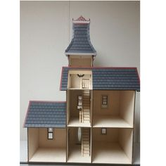 The Hamlin Victorian dollhouse kit is laser cut for precision piecing and measures wide X deep and tall. It is cut from Baltic birch plywood. Dollhouse Kits, Victorian Dollhouse, Dollhouse Miniatures, Baltic Birch Plywood, Dollhouses, Laser Engraving, Hamilton, Scale, Models
