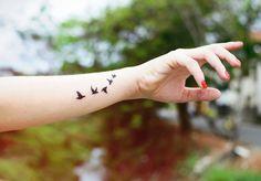 Tatuagens femininas de pássaro – dicas e fotos