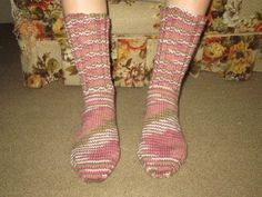Here is a wonderful pair of hand knit adult size socks. Heel to toe is approx. 9 1/2 in. and the ribbing on the top (top to ankle) is approx. 6 1/2 in. The yarn color is called Pink Camo. These socks are made of 100% acrylic yarn and can be machine washed and dried.