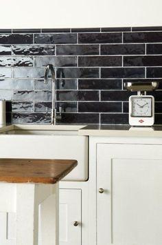 Sloe dark brick tiles are glossy and subtly textures. From the Cosmopolitan range at The Winchester Tile Company. Handmade ceramic tiles, made in the UK. winchestertiles.com