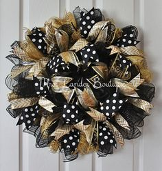 Hey, I found this really awesome Etsy listing at https://www.etsy.com/listing/219720416/black-and-gold-deco-mesh-wreath-ucf-door