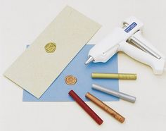 Sealing wax glue gun. The MUCH simpler way to apply sealing wax to an invite.