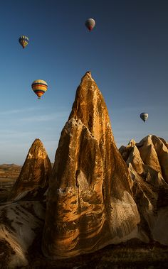 Go hotair ballooning in Cappadocia, Turkey! I have already been to Cappadocia and many other places in Turkey and fell in love. It is GORGEOUS there!! I would love to go back and ride in a hot air balloon over it all :)