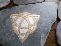 Washed up slate from east coast beaches, carved with designs.