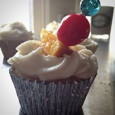 """An Old Fashion Cupcake made with Jack Daniel's Whiskey, filled with a very boozy orange liquor cream center, and topped with Jack Daniel's buttercream…"""