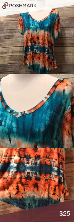 Tye dye top Short sleeves. V neck. Hemline comes to a point in the front and back. Size 2x. Super soft!  25 bust 30-32 length. All measurements are approximate front of closet Tops