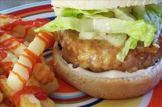 Ground Chicken Burgers Ingredients:  1 lb ground chicken 1/2 cup mozzarella cheese, grated 5 tablespoons breadcrumbs 1/4 cup barbecue sauce Directions: 1.Mix together everything except for 1/2 the barbecue sauce. 2.Grill on barbecue. 3.While grilling add rest of the barbecue sauce.