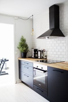 Black kitchen white french tiles Ingrid Holm home
