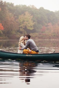 2 - Romantic Couple Kissing In Canoe On the Water