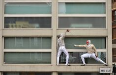 Jonathan Webb and Soji Aiyenuro British fencers taking part in a calendar photoshoot at fencing related street signs around London for their sponsor, specialist insurer Beazley on November 24, 2013 in London, England. (November 23, 2013 - Source: Christopher Lee/Getty Images Europe)