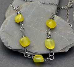 Sterling silver and olive jade necklace. £22.00
