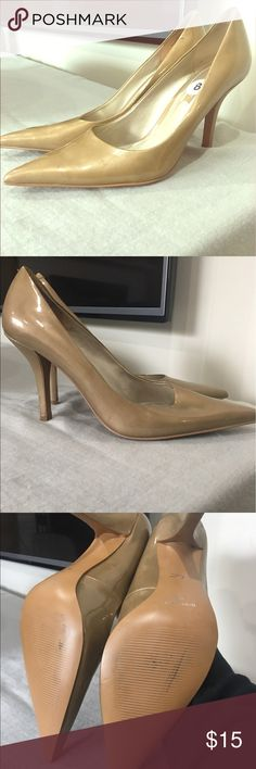 Nine West Golden Nude Pumps Never worn. Minimal scuffs (barely noticeable) from moving them. Pretty golden nude color. Nine West Shoes Heels