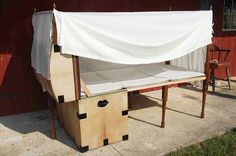 century design folding bedstead with bedding (tic) contained in a hide covered trunk. read more about this-- do!