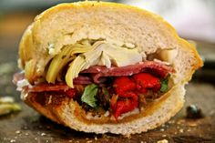ANTIPASTO SANDWICH by Sam The Cooking Guy  -  This masterpiece is stuffed with melty cheese and salami, salty tapenade and roasted red peppers – just to name a few ingredients. There's no need to eat lunch out when you know how to make a sandwich like this! To get the full recipe, simply click on the photo.  ENJOY!