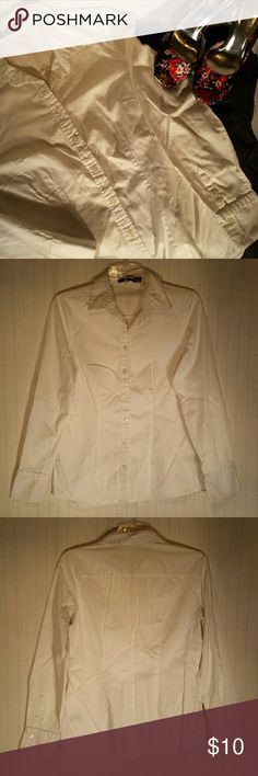 White Essential Shirt The Limited white essential button down shirt.  3 button cuff.  No stains.  Very soft and comfortable.   98% Cotton / 2% Spandex.  Excellent condition. No rips, stains, or imperfections. Smoke free house.   Reasonable offers are accepted and I discount bundles. Check out my other tops and make an offer. The Limited  Tops Button Down Shirts