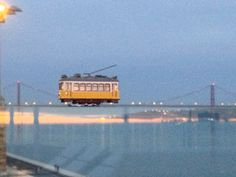 Lisbon tram over the river