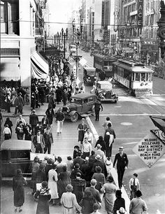 This photograph taken at Seventh street and Broadway yesterday morning shows what little effect the strike on the Los Angeles Rail way street-car lines had on business activities in the retail shopping district. Normal trolley car operations are apparent. (Los Angeles Times, Nov. 25, 1934).