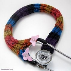 This Stethoscope cover is hand knitted with a multi colored sock yarn, you will see, purple, black, blue, orange, yellow and pink. A friend of mine is a nurse and she asked me if I could knit her a stethoscope cover that is not so bulky like the cloth ones.This multicolored stethoscope sock is knitted in the round so it has no seams and has a very good stretch to it, so you can easily pull it over the bell.And just snap the buttons close on each leg.It has two legs with snaps on it so it ...