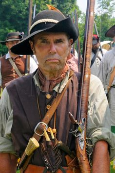 Lebanon Towne Militia men march with shouldered muskets during a drill at a Revolutionary War encampment and muster, the Nathan Hale Homeste...