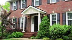 Brick colonial home with portico covered stoop