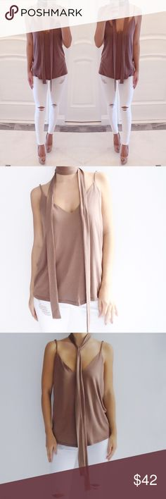 🆕 • Mya Tank with Choker Neck Tie Brown spaghetti strap tank with neck tie. Straps are adjustable. Low v-neck back. Very soft and comfy material. 70% Modal, 30% Polyester. *Modeling size Small*  ☑️ NO trades. Price is FIRM unless bundled. ☑️ Sizes Available: Small, Medium, and Large (ONE left). Tops Tank Tops
