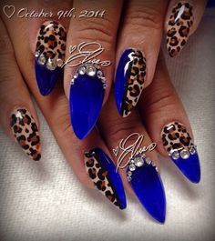 Blue, leopard print & rhinestone nail art