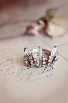 Baguette and round cut diamonds set in a crown shape setting. Stunning!