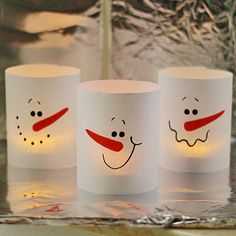 wrap votive cups with paper snowman cylinders