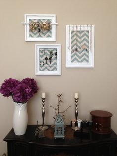 I'm going to use shadow boxes. Glue fabric to the inside, paint small dowel rodes and attach them to the inside.