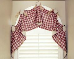 Haley Valance Sewing Pattern mounted on an arched window