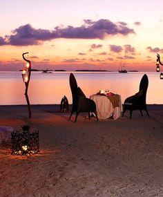 Torchlight dining at Anantara Kihavah Villas, Maldives