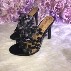 """🎀Flower Girl-Black 🎀Brand New.  🎀In Box 📦  🎀Material:PVC 🎀Measurement: 4.75""""Heel 🎀Features      🎀Floral-embellished design (Shoes run one size small, recommend you choose one size up.)      🎀Easy slip on construction      🎀Open toe with stiletto heel 🎀Show off some sweet style in these delightful mule sandals. Featuring pvc upper,open toe front,easy slip on design,floral accents at vamp. 💥Once Size Is Out It Will No Longer Be Restocked ⚠️If you do not like the item you CANNOT…"""