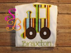 Boy train onesie made by Shana's Boutique