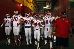 The Utah football team walks onto the field at the The Los Angeles Memorial Coliseum. (Chris Detrick     The Salt Lake Tribune)